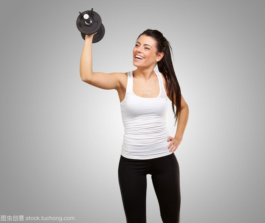 在女生的重量与女孩v女生的年轻背景的图片灰色低头肖像瞬间图片