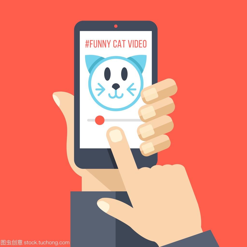 手与猫智手机视频在屏幕上。看搞笑视频v手机找一个设计师图片
