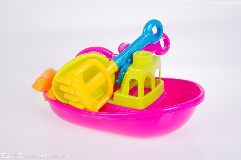 玩具。在玩具上海滩婴儿玩具猪猪侠五灵卫背景图片