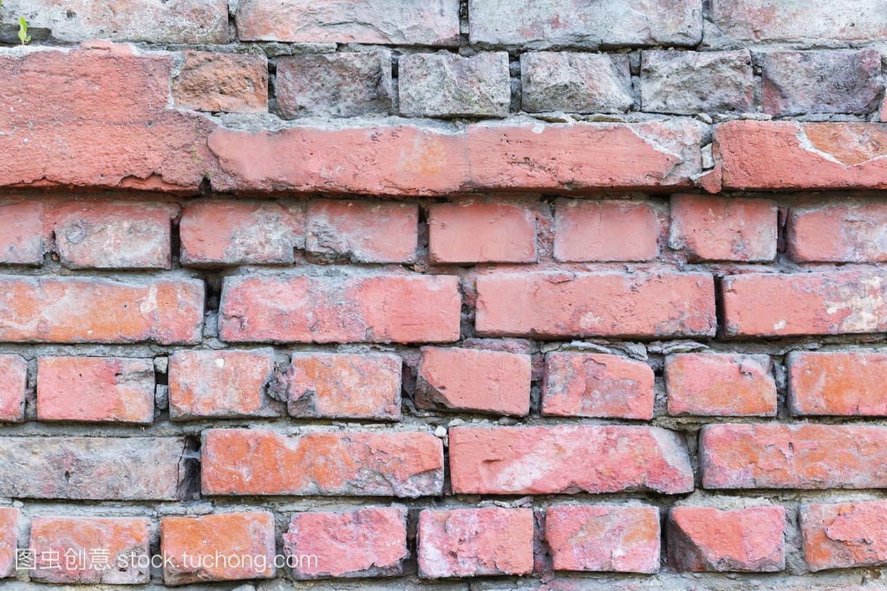 纹理的红砖grunge背景墙上用渐晕光的工业设计uiv纹理区别图片