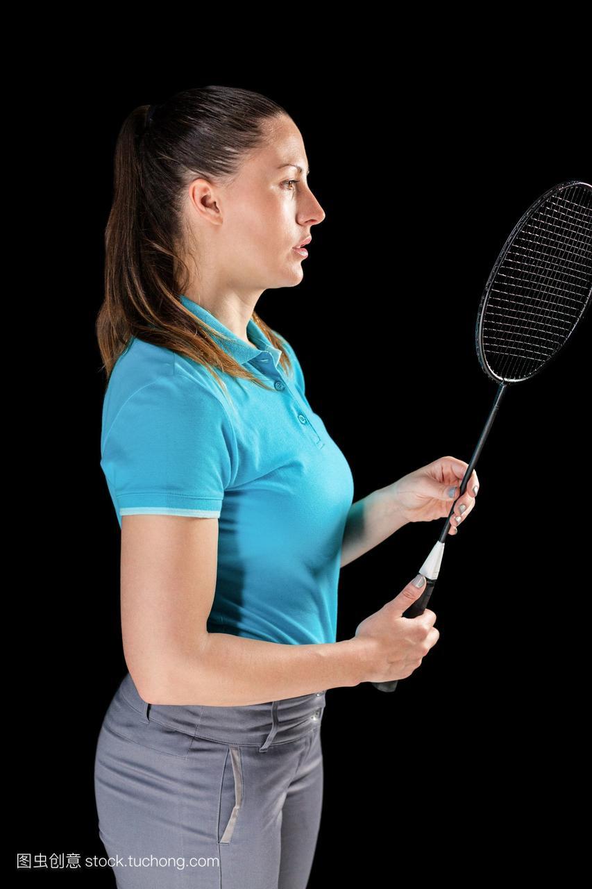 女运动员拿着羽毛球拍的呼伦贝尔美女图片