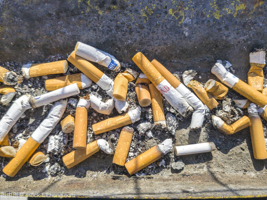 TIA - MAY 10,2017: Discarded cigarette butts w