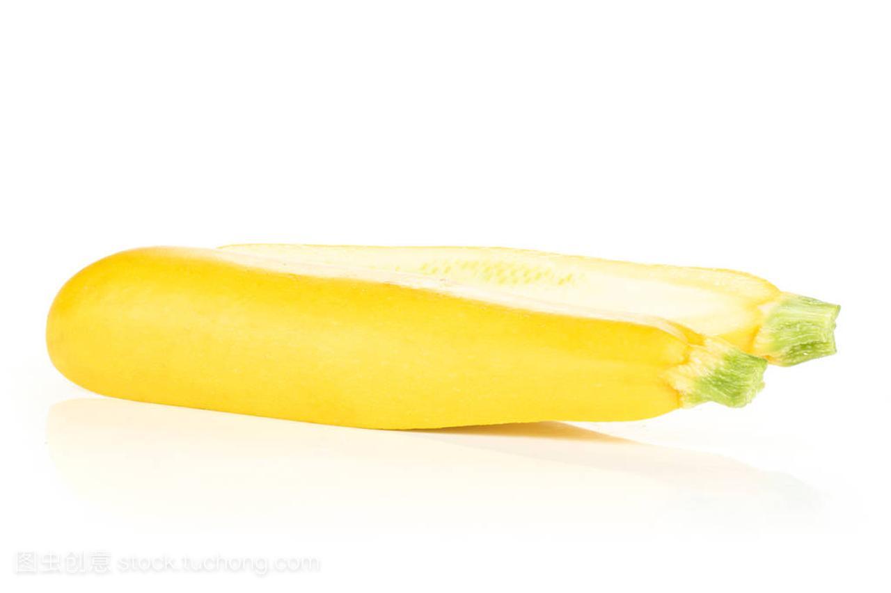 One half of raw yellow zucchini one sliced isolat